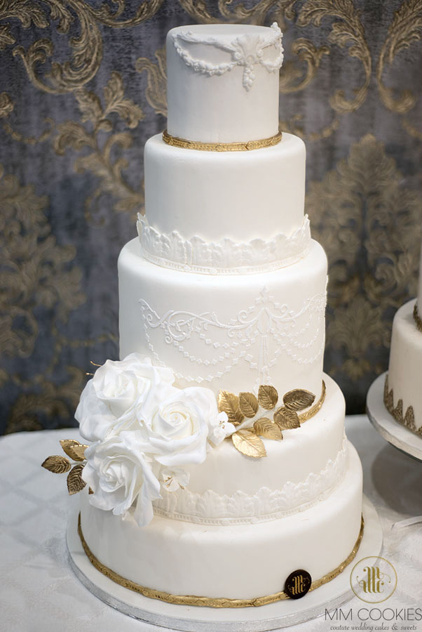 Elegant white with gold wedding cake